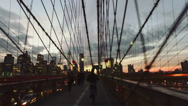 bicycle pov: night ride on the brooklyn bridge, ny city - street light stock videos & royalty-free footage