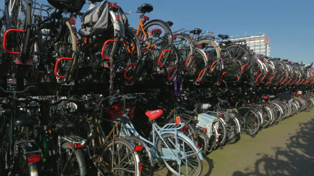 bicycle parking at central station, amsterdam, north holland, netherlands - bicycle parking station stock videos and b-roll footage