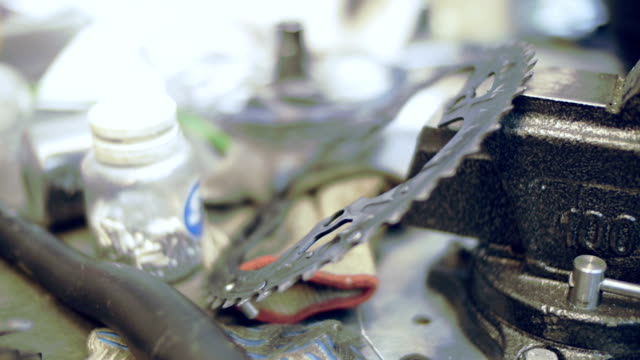 bicycle parts in a workshop - puncture repair kit stock videos & royalty-free footage