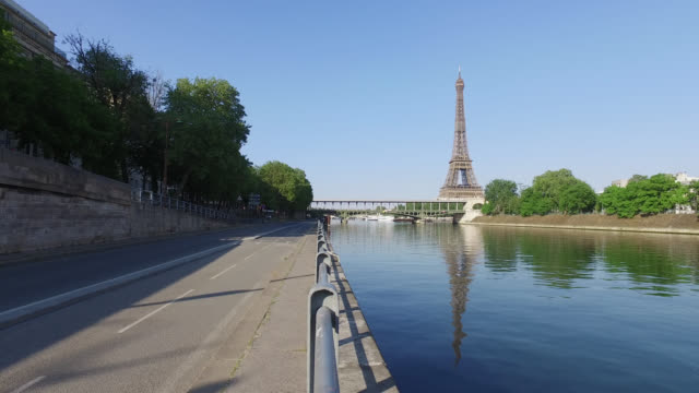 bicycle path and eiffel tower.paris - eiffel tower paris stock videos & royalty-free footage