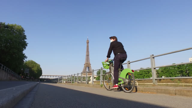 bicycle path and eiffel tower.paris - paris stock videos & royalty-free footage