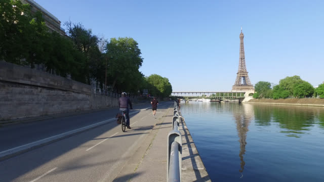 bicycle path and eiffel tower.paris - river seine stock videos & royalty-free footage