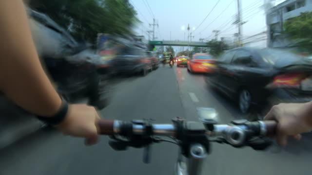 bicycle point of view biking  traffic bangkok,thailand - danger stock videos & royalty-free footage