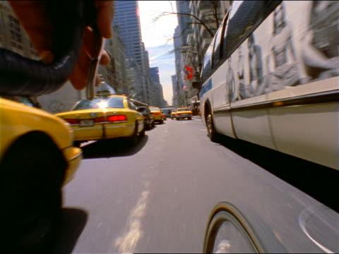 vídeos de stock, filmes e b-roll de bicycle point of view riding thru traffic on busy city street / nyc - 1990 1999