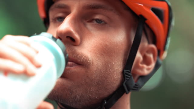 bicycle racing cyclist: drinking - cycling helmet stock videos & royalty-free footage