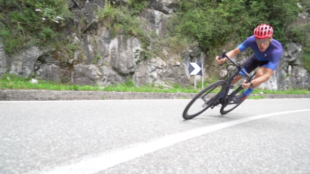 bicycle racing cyclist: fast in slow-motion - steep stock videos & royalty-free footage