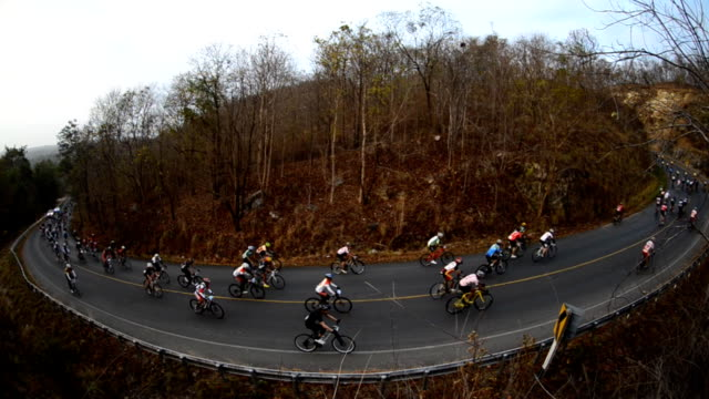 bicycle racing up to mountian - coiled spring stock videos and b-roll footage