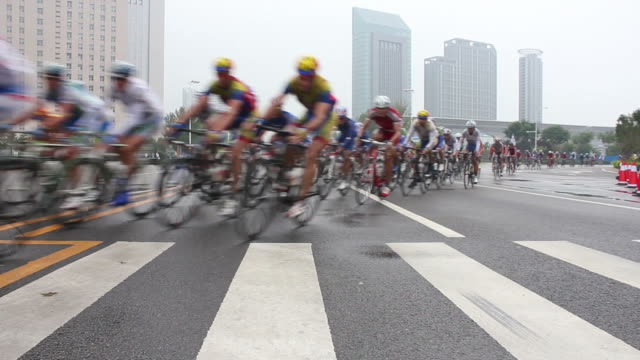 ws la bicycle racing with sponsor cars following behind/xian,shaanxi,china - cycling event stock videos & royalty-free footage