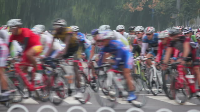 ls bicycle racing with sponsor cars following behind/xian,shaanxi,china - cycling event stock videos & royalty-free footage