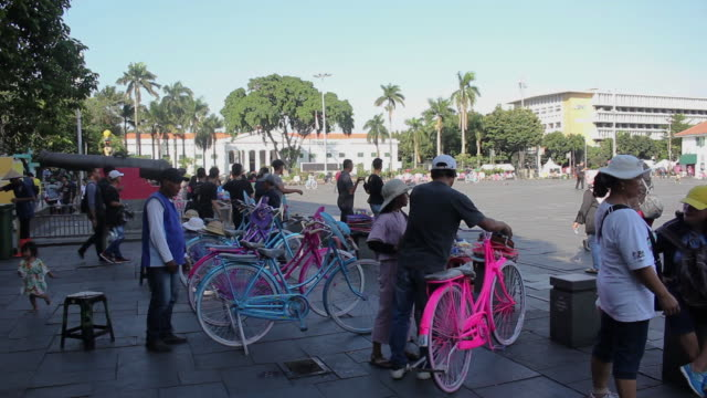 bicycle rental at old city tourism in jakarta - indonesia street stock videos & royalty-free footage