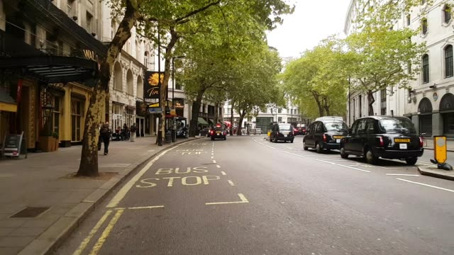 bicycle ride in london aldwych - taxi stock videos & royalty-free footage
