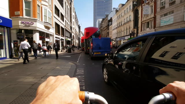 bicycle ride in london oxford street to the east - double decker bus stock videos & royalty-free footage