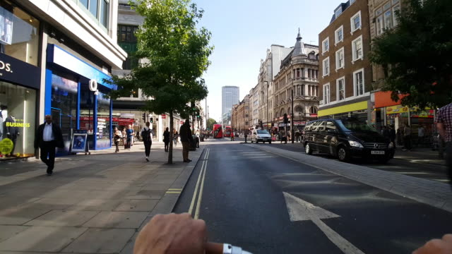 bicycle ride in london oxford street - shop window stock videos & royalty-free footage