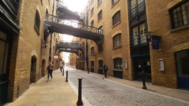 bicycle ride in london shad thames - street stock videos & royalty-free footage