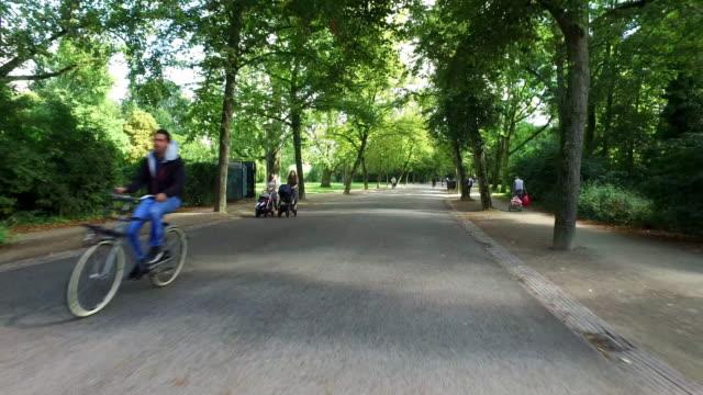 pov: bicycle ride in vondelpark amsterdam - vondelpark stock videos and b-roll footage