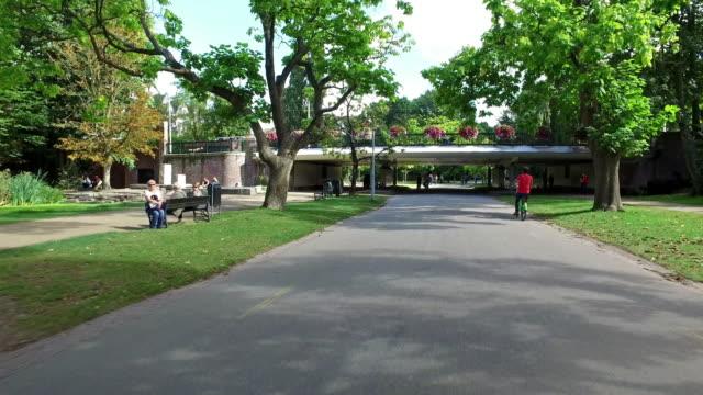 bicycle ride in vondelpark amsterdam - vondelpark stock videos and b-roll footage