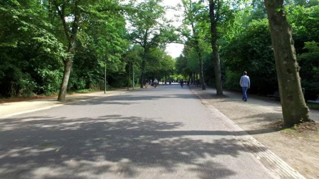4k pov: bicycle ride in vondelpark amsterdam - vondelpark stock videos and b-roll footage
