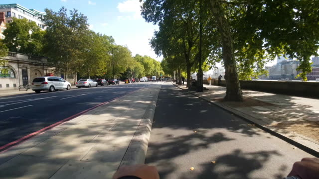 bicycle ride on london cycle superhighway 3 at victoria embankment - riverbank stock videos & royalty-free footage