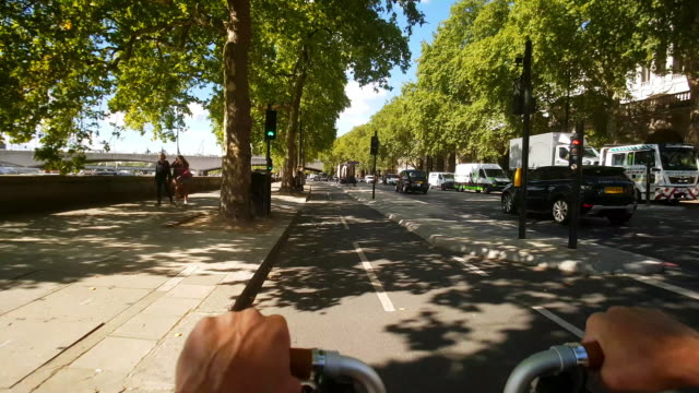 bicycle ride on london victoria embankment at temple district - temple building stock videos & royalty-free footage