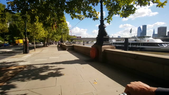 bicycle ride on london victoria embankment - riverbank stock videos & royalty-free footage