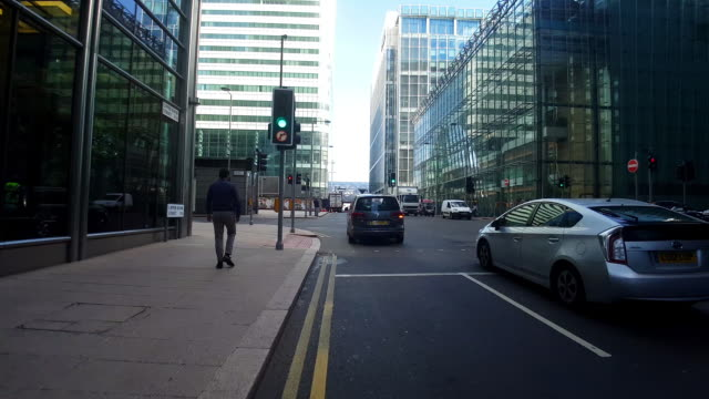 bicycle ride through london canary wharf - traffic time lapse stock videos & royalty-free footage