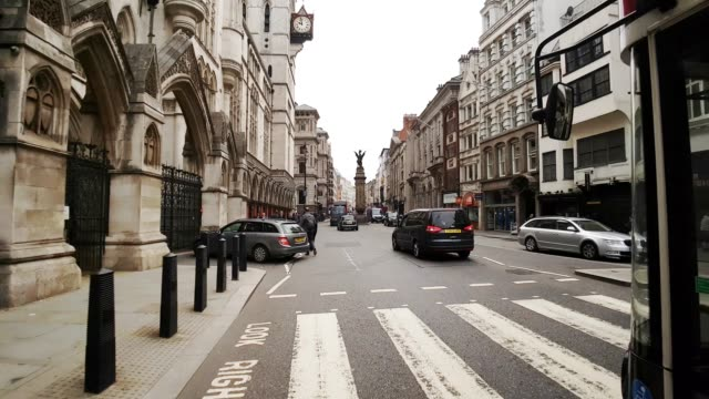 bicycle ride through london the strand road - royal courts of justice stock videos & royalty-free footage
