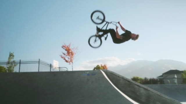 bmx bicycle rider in a skate park - stunt stock videos & royalty-free footage