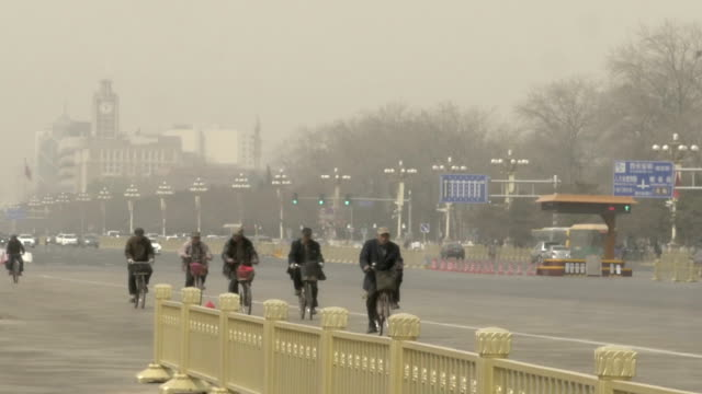 bicycle riders near tiananmen square - tiananmen square stock videos and b-roll footage