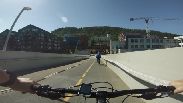 pov bicycle riding: biking together in bergen - copenhagen stock videos and b-roll footage