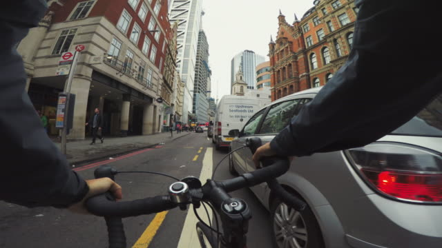 pov bicycle riding: commuter with road racing bike in london - road sign stock videos & royalty-free footage