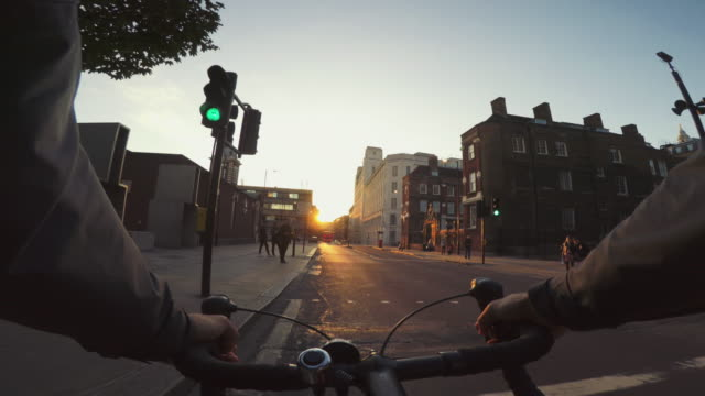 pov bicycle riding: commuter with road racing bike in london - bicycle stock videos & royalty-free footage