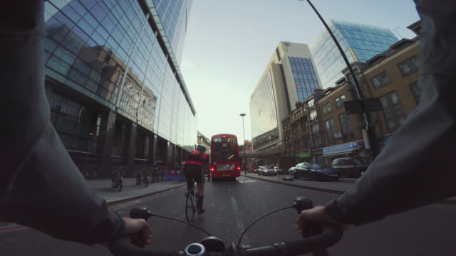 pov bicycle riding: commuter with road racing bike in london - cycling stock videos & royalty-free footage