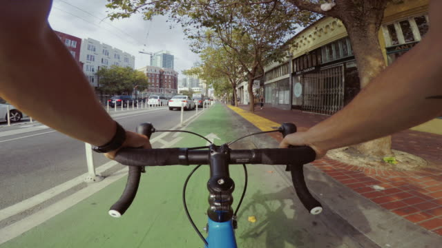 pov bicycle riding: commuter with road racing bike in san francisco - motorcycle biker stock videos & royalty-free footage