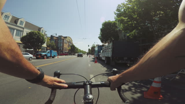 pov bicycle riding: commuter with road racing bike in san francisco - racing bicycle stock videos and b-roll footage