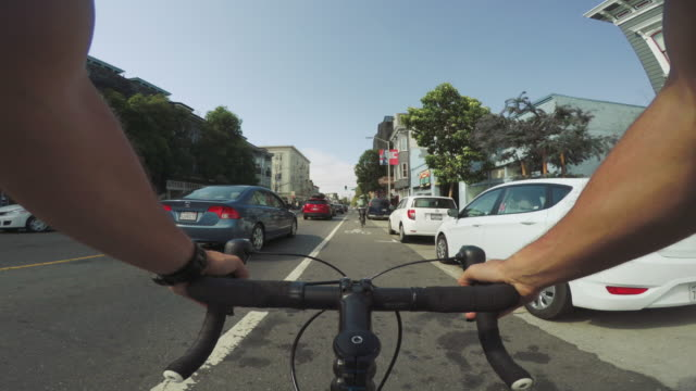 POV bicycle riding: commuter with road racing bike in San Francisco
