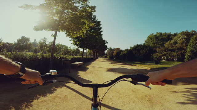 pov bicycle riding in a park in barcelona - handlebar stock videos & royalty-free footage
