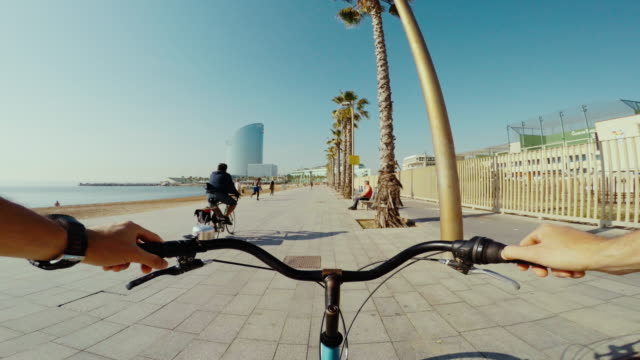 pov bicycle riding in barcelona summer vacations - barcelona spain stock videos & royalty-free footage