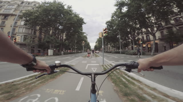 pov bicycle riding in the city, barcelona, spain - point of view stock videos & royalty-free footage