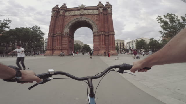 pov bicycle riding in the city, barcelona, spain - barcelona spain stock videos & royalty-free footage