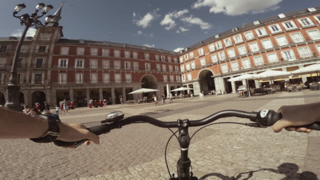 pov bicycle riding in the city life of madrid, spain - 自動車部品点の映像素材/bロール