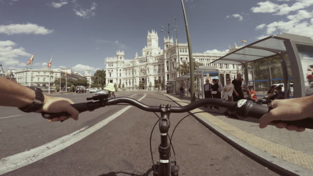 POV bicycle riding in the city life of Madrid, Spain
