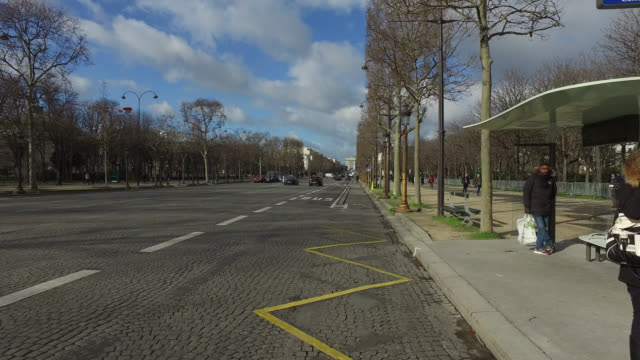 pov bicycle riding in the city life of paris. street of paris - arc de triomphe paris stock videos & royalty-free footage
