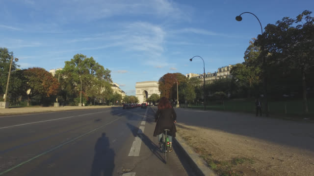 pov bicycle riding in the city life of paris - point of view stock videos & royalty-free footage