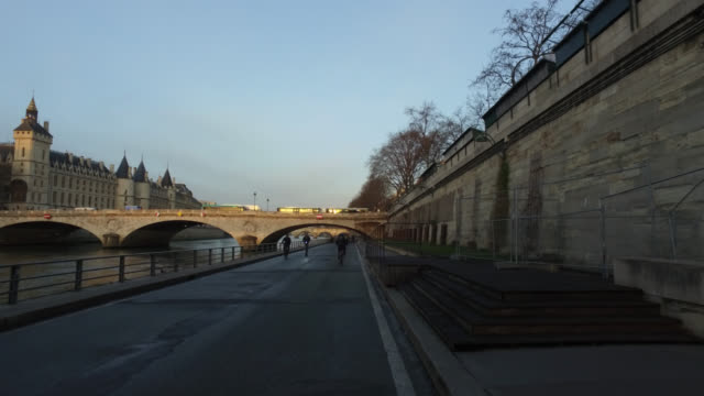 pov bicycle riding in the city life of paris - river seine stock videos & royalty-free footage
