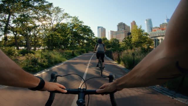 pov bicycle riding: man with road racing bike in new york - point of view video stock e b–roll