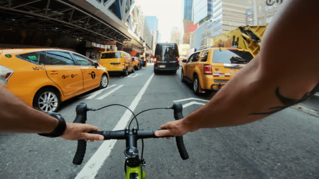 pov bicycle riding: man with road racing bike in new york - motorcycle biker stock videos & royalty-free footage