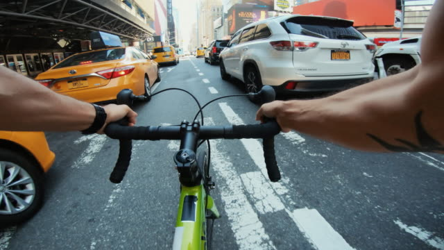 pov bicycle riding: man with road racing bike in new york - wearable camera stock videos & royalty-free footage