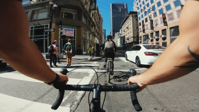 pov bicycle riding: tourists with road racing bike in san francisco - handlebar stock videos & royalty-free footage