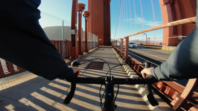 pov bicycle riding: with bike on the golden gate bridge - golden gate bridge stock videos & royalty-free footage