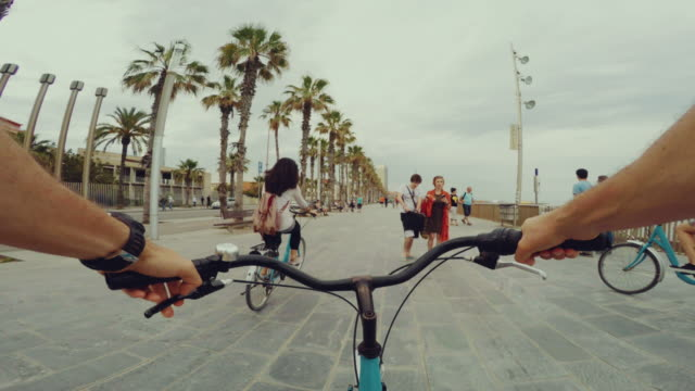 pov bicycle riding with two nice girls - point of view stock videos and b-roll footage